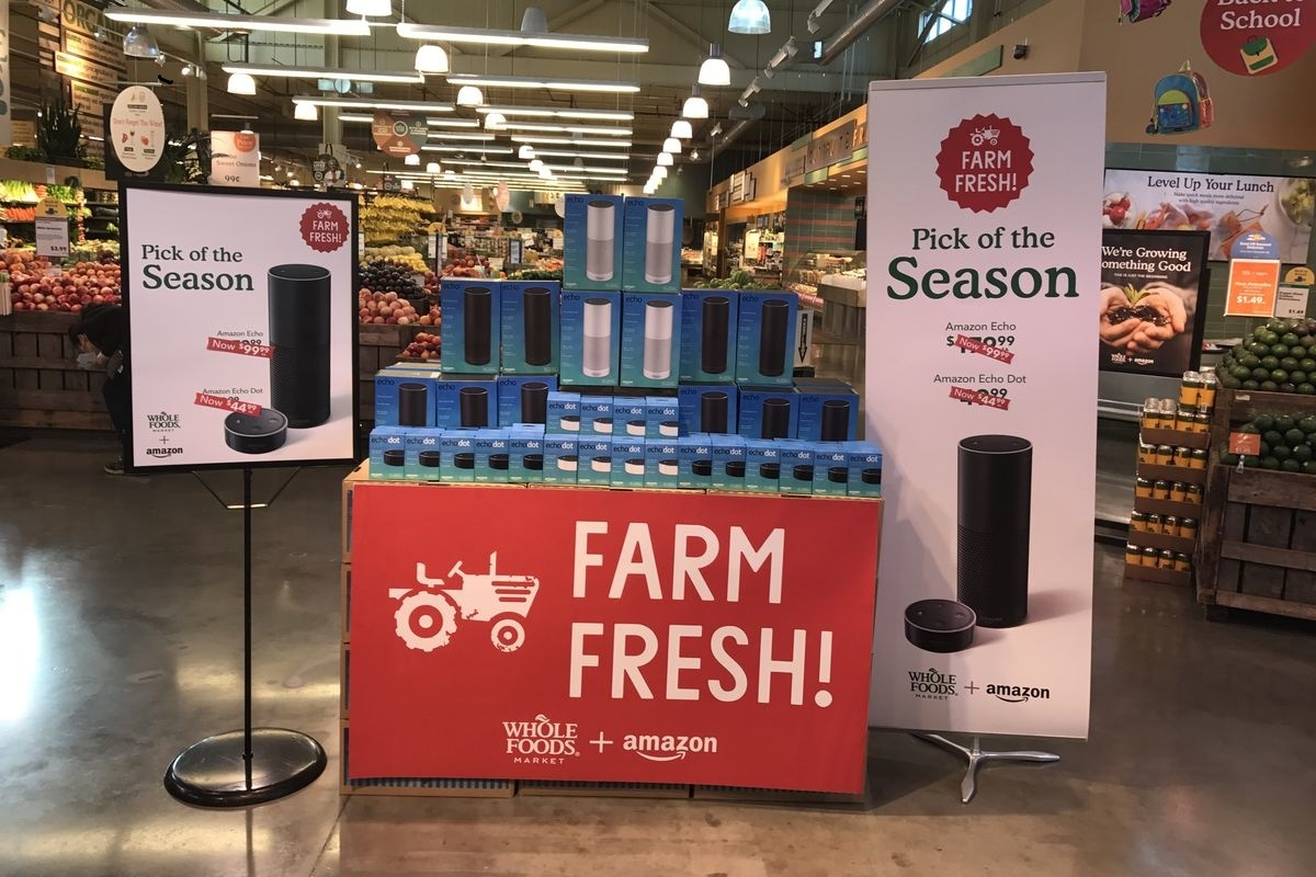 Amazon devices like the Echo smart speaker, Fire tablet and Kindle e-reader are on display in stores